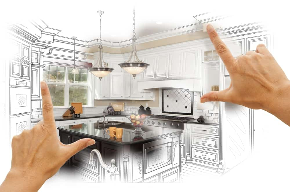 Hands envisioning a new kitchen.