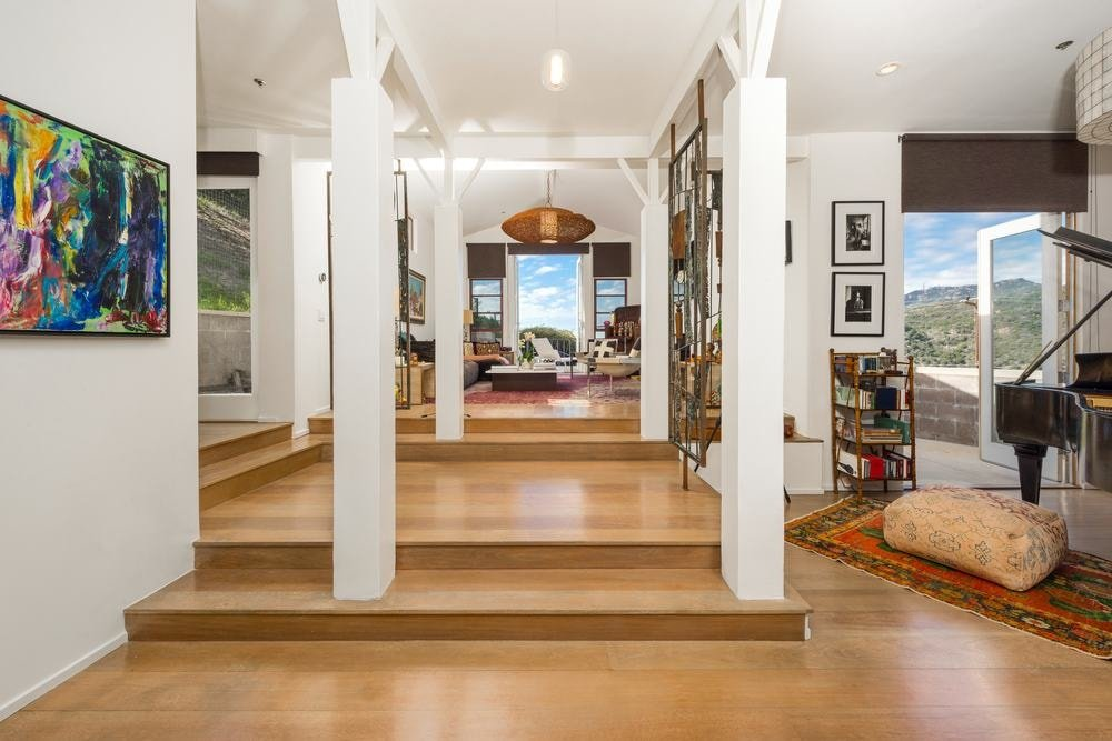 Upon entry of the house, you are welcomed by this simple yet homey foyer with lovely hardwood flooring and tall beige pillars that blend quite well with the ceiling.