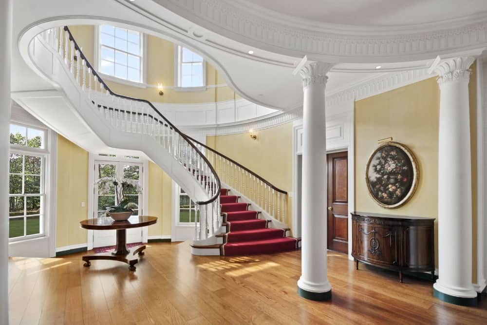 Entry foyer featuring hardwood flooring and a Romantic-style ceiling. The walls look charming as well.