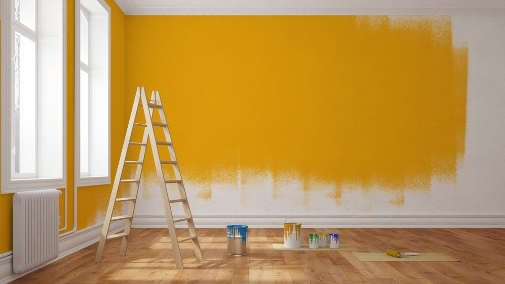 Painting the walls with yellow.