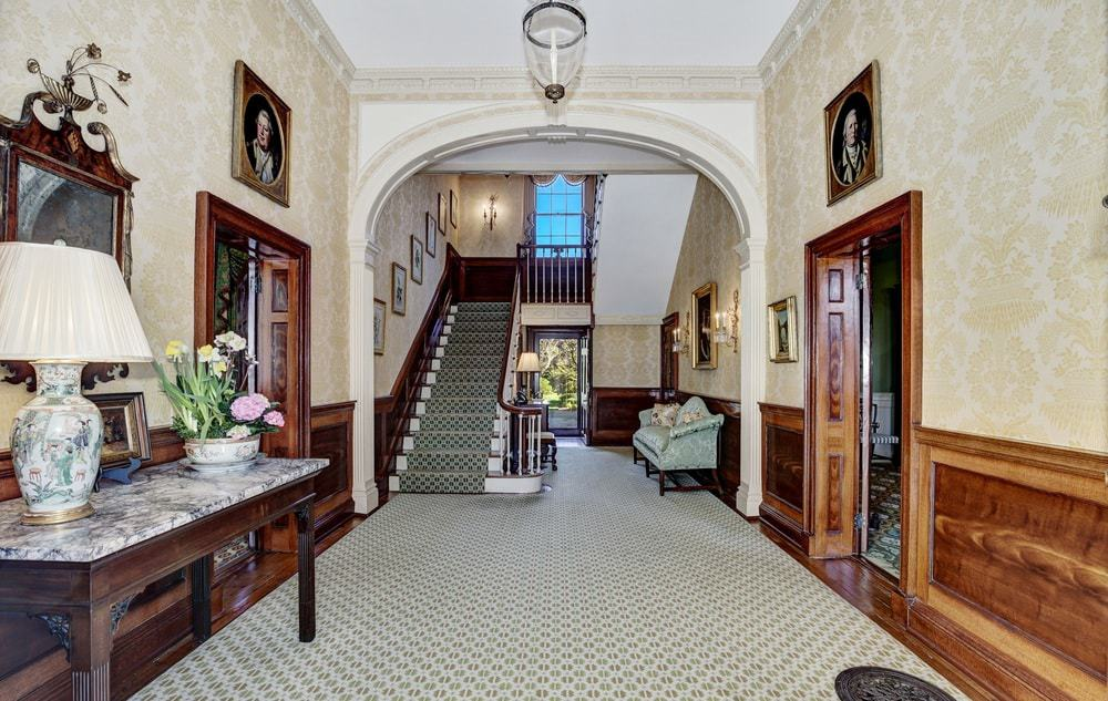 Upon entry of the main door of the house, this foyer welcomes you with its familiar homey feel adorned with a wooden console table on the side bearing decors and a lamp.