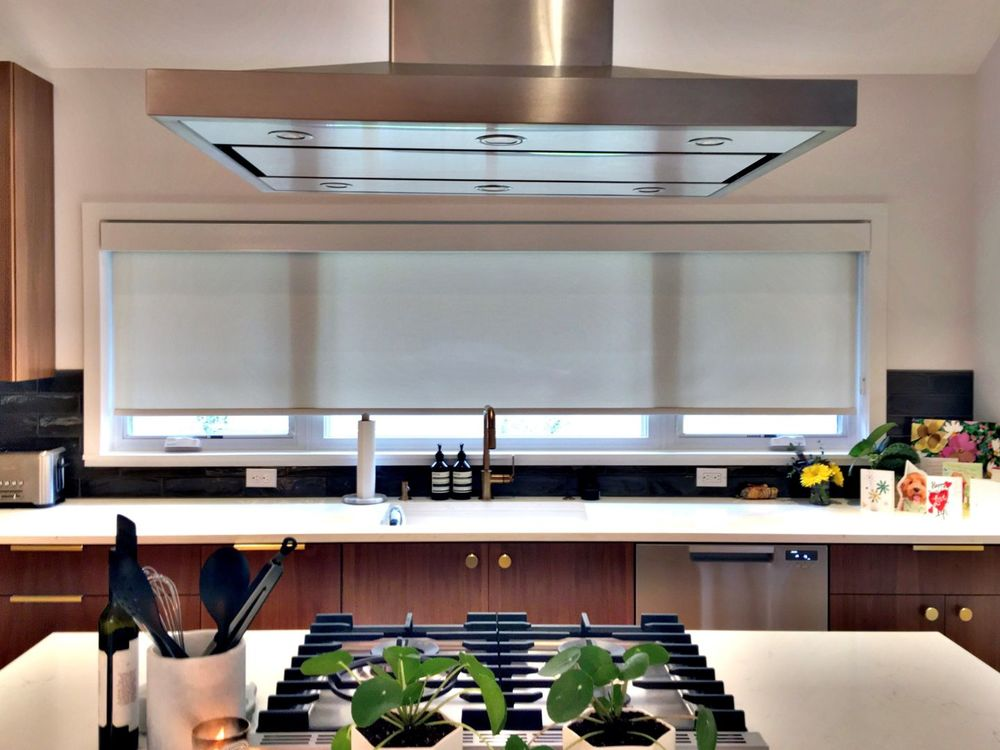 Roller Shades in a Kitchen with a Modern Range Hood