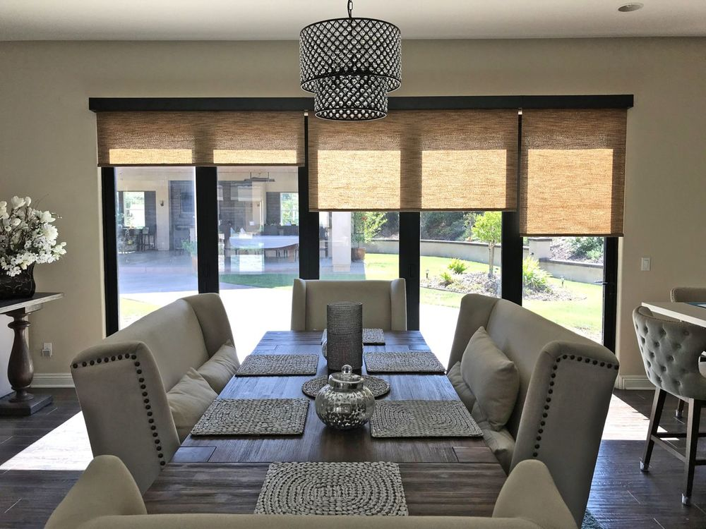 Soft Woven Motorized Roller Shades in a Dining Room