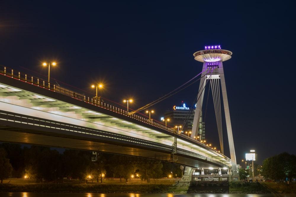 SNP bridge in Slovakia seen at night.
