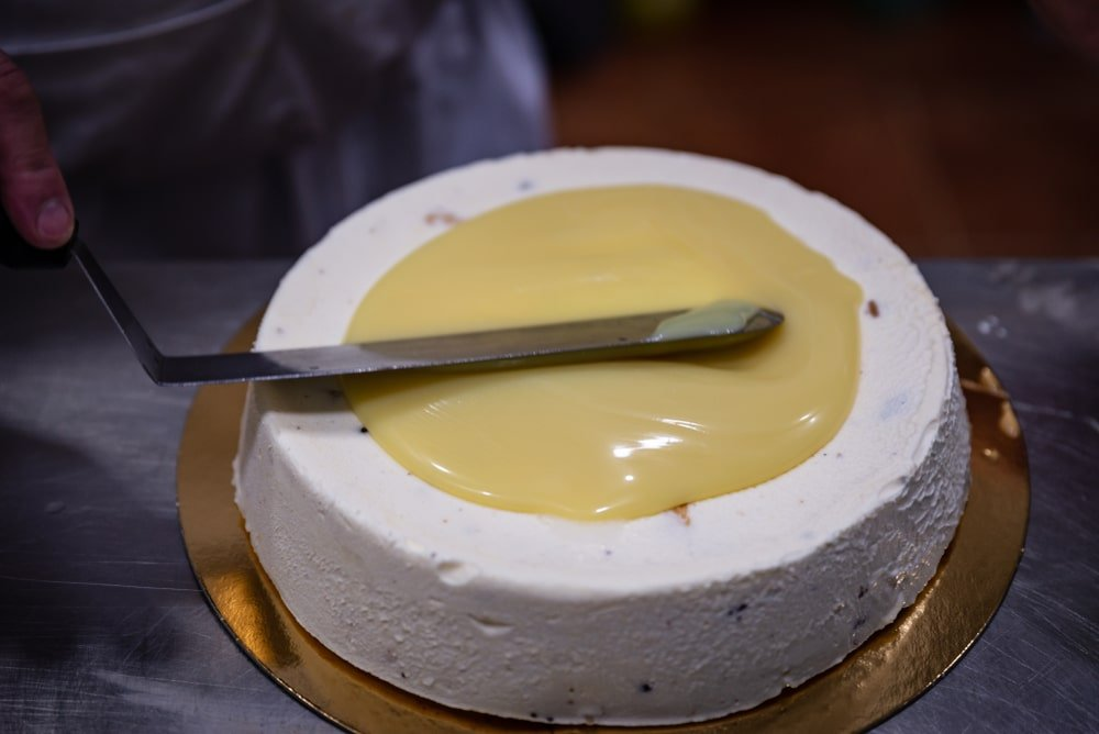 Spatula used to spread icing on top of a cheesecake.