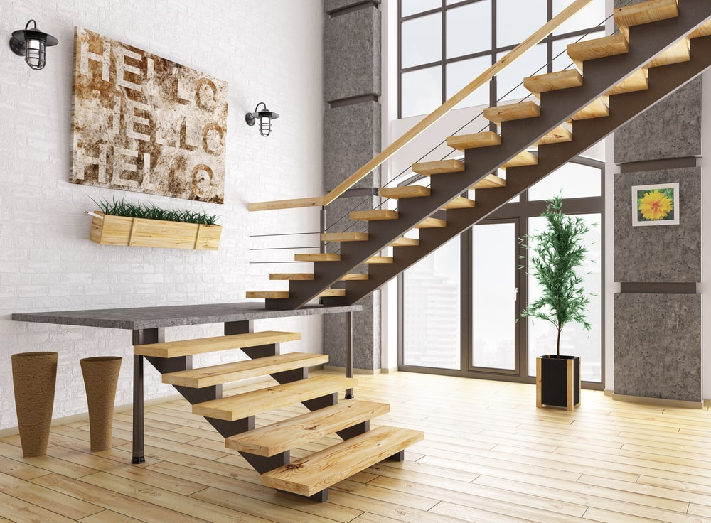 Modern house with a stylish staircase with wooden steps. The area has hardwood floors and a two-storey ceiling.