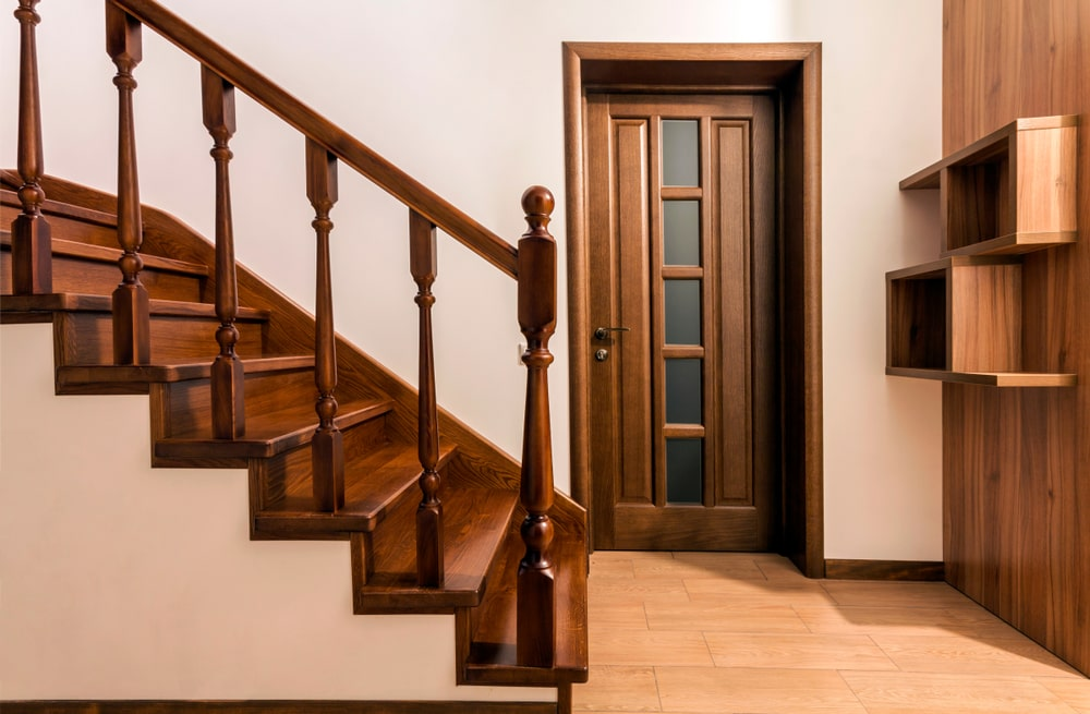 A newly renovated home featuring a modern staircase made out of brown oak wood.