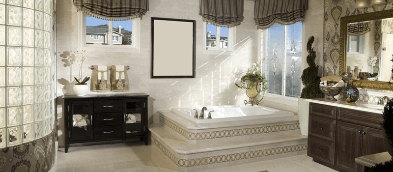 Victorian-style primary bathroom with a lovely bathtub setup, along with a stunning walk-in shower room. The room adds two sink counters as well.