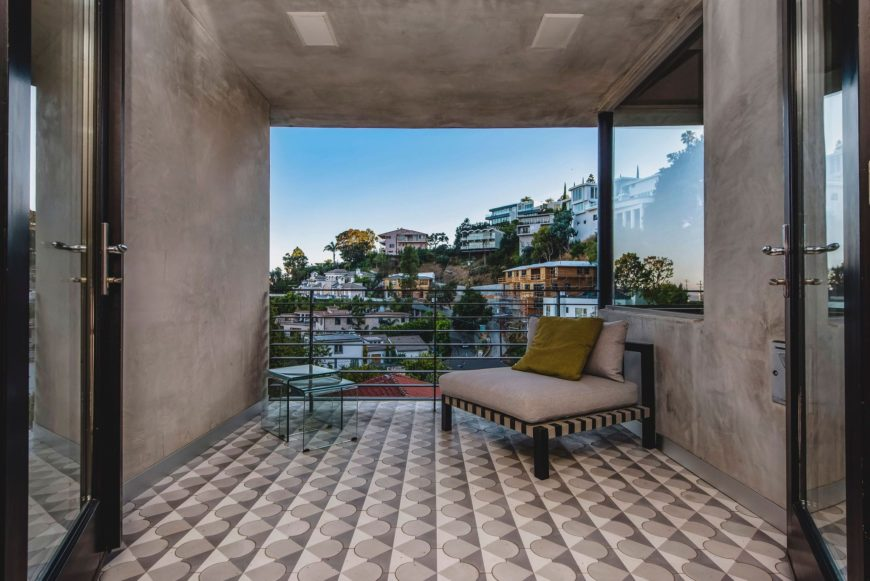 A sitting area outside of the home's bedroom, overlooking the stunning surrounding areas. Images courtesy of Toptenrealestatedeals.com.
