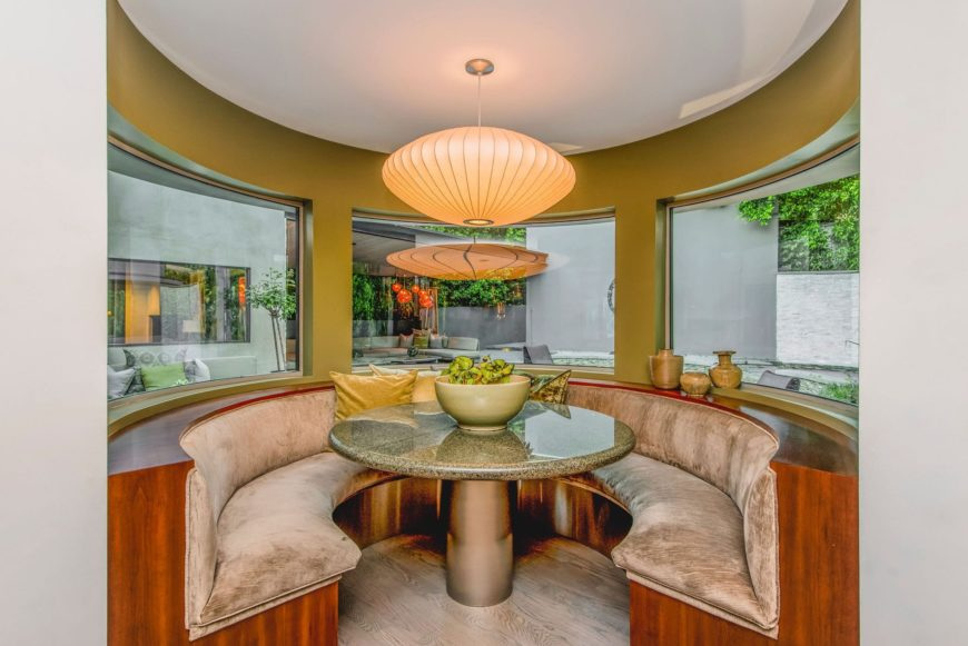 A focused look at the home's dining nook featuring a granite top dining table lighted by a charming ceiling light. Images courtesy of Toptenrealestatedeals.com.