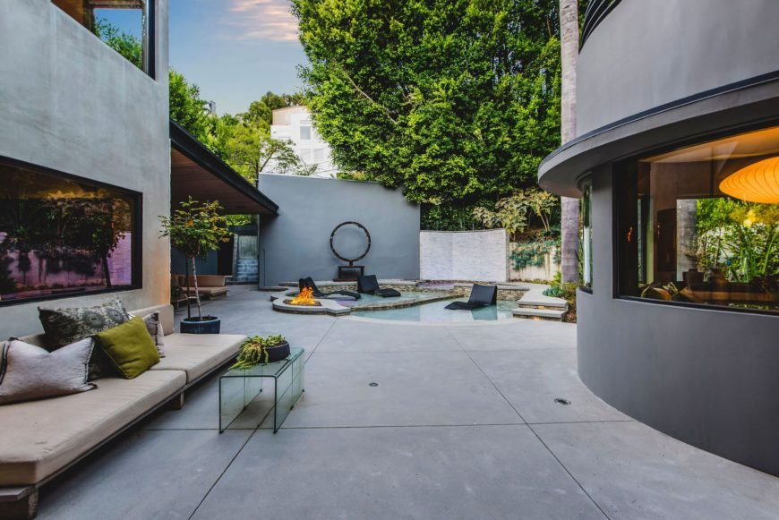 The outdoor area features a cozy sofa set and a glass center table, along with a custom swimming pool. Images courtesy of Toptenrealestatedeals.com.
