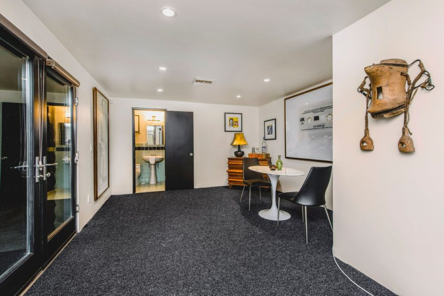 This area of the house features dark gray carpet flooring, white walls and a white ceiling lighted by recessed ceiling lights. Images courtesy of Toptenrealestatedeals.com.