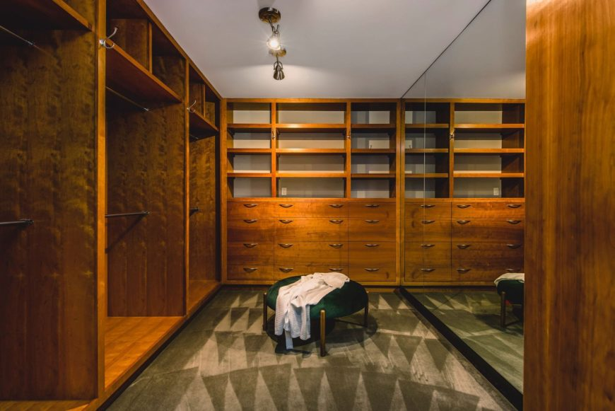 There's a large closet as well, featuring wooden cabinets and drawers, along with carpeted flooring. Images courtesy of Toptenrealestatedeals.com.