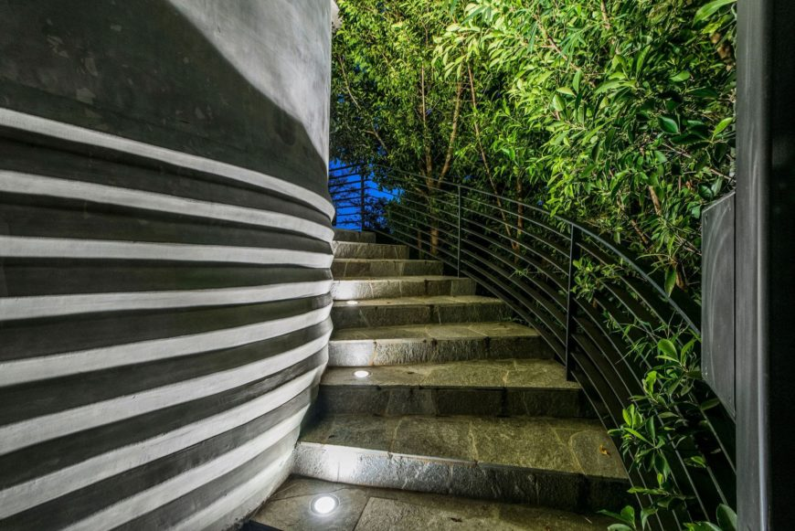 A closer look at the home's outdoor staircase leading to the home's second floor. Images courtesy of Toptenrealestatedeals.com.