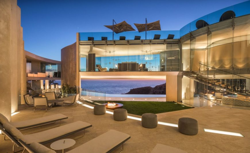 Here's the look of the sitting lounges on the side of the outdoor area of the home. There's also a living space set as well. Images courtesy of Toptenrealestatedeals.com.