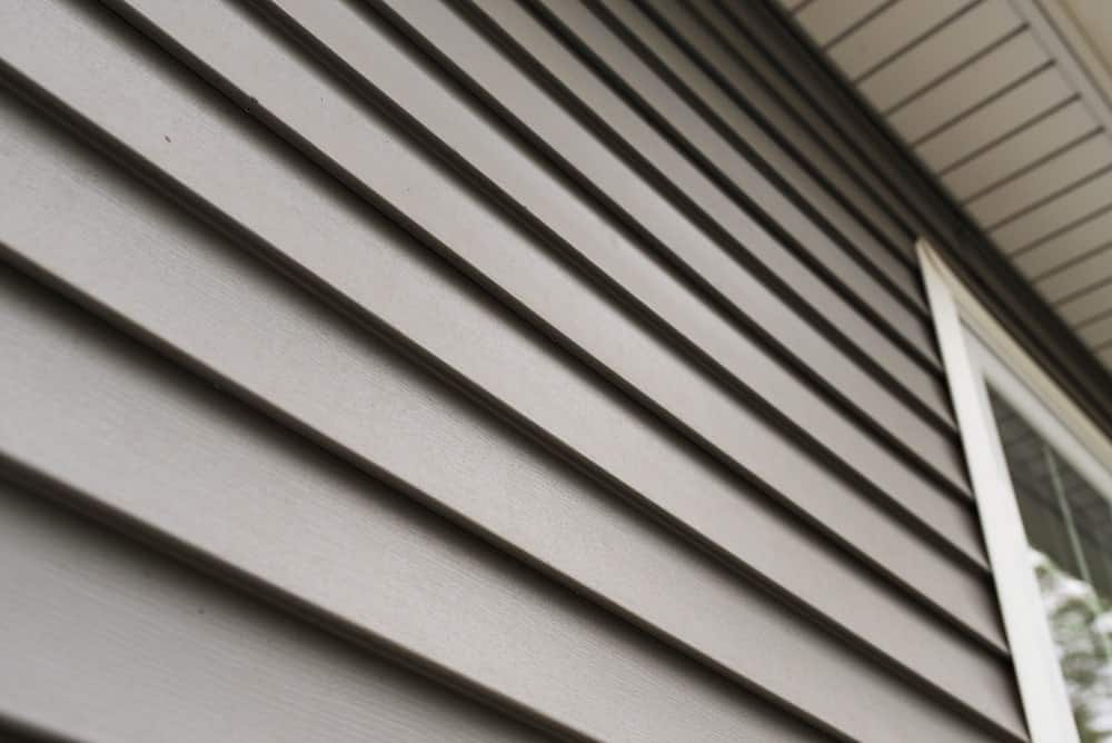 This is a close-up look at the gray vinyl siding of a new home.