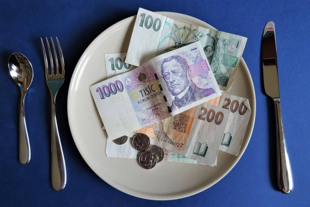Banknotes and coins served for a meal.