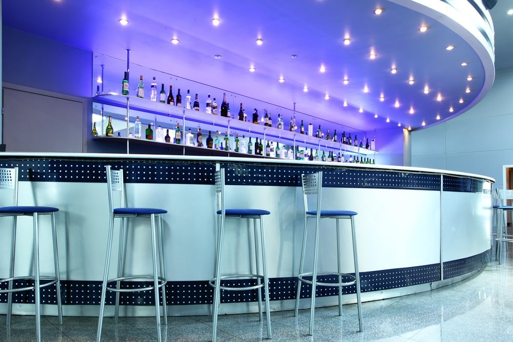 Bar interior with counter stools.