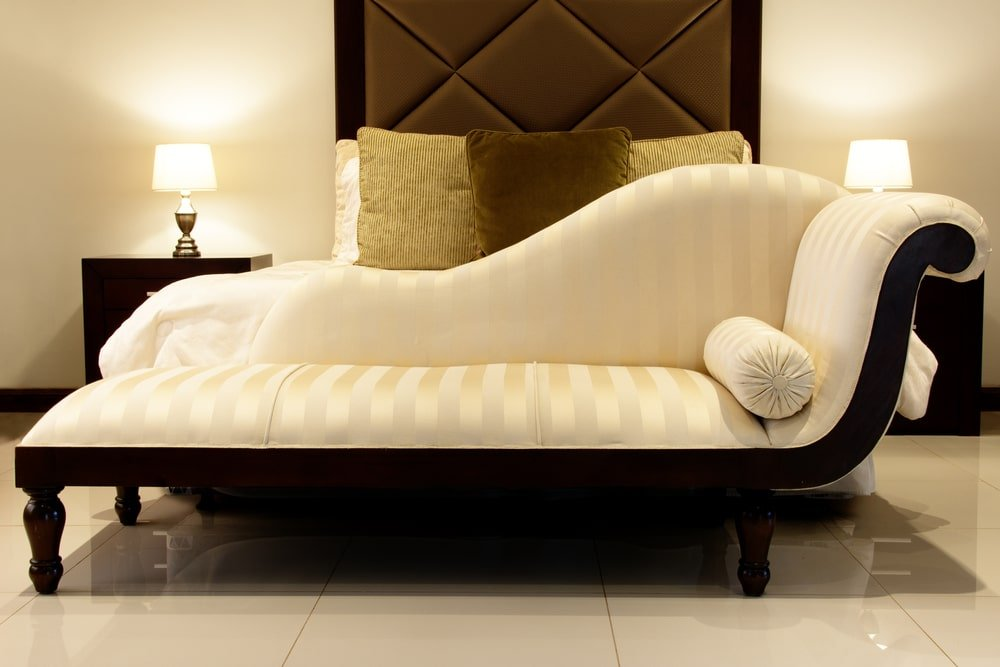 Chaise lounge in a bedroom.