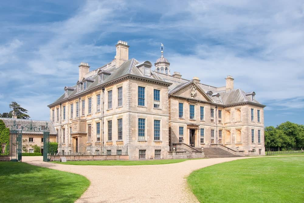 A focused look at this 17th century English Mansion located in Belton, United Kingdom. It has a classy exterior and wide lawn area with walkways.