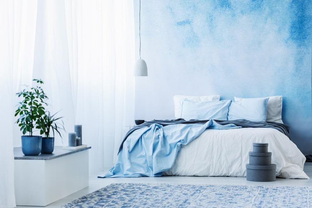 Sky blue bedroom interior.