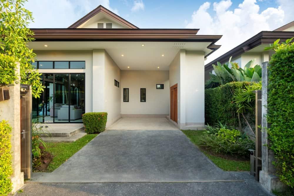A suburban home with a tiny carport.