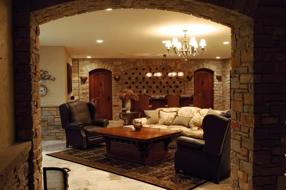 Luxury home cellar with a living room area and bar.
