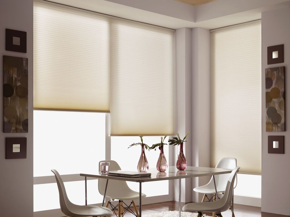 Cellular shades in an elegant dining room.