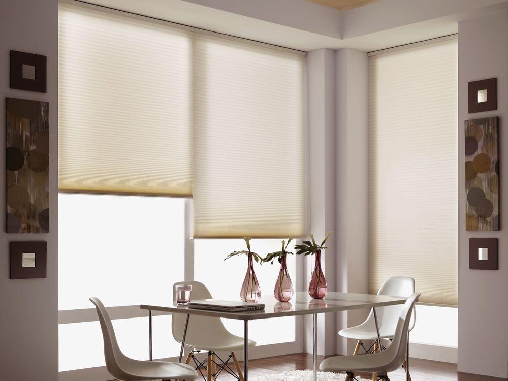 Cellular shades in an elegant dining room.