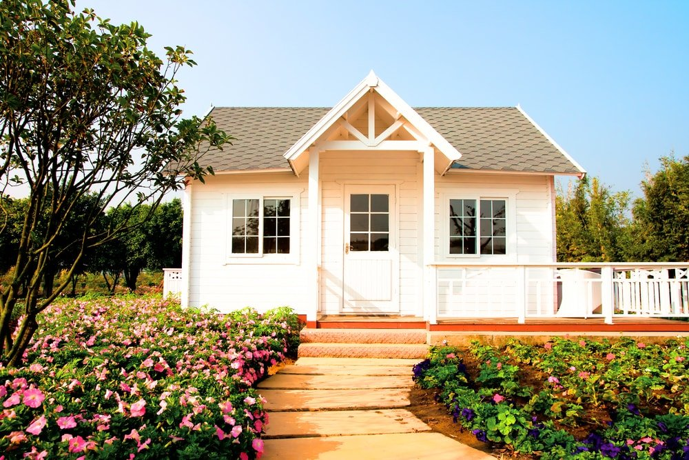 Cottage home with front garden and footpath.