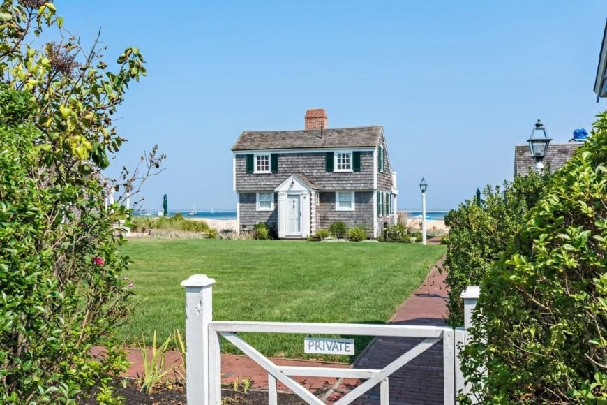 The large property of this home is enhanced by the Cottage-style landscaping. There is a low gate at the entrance that opens to red brick walkways that surround the large lawn of grass big enough for any home celebration.