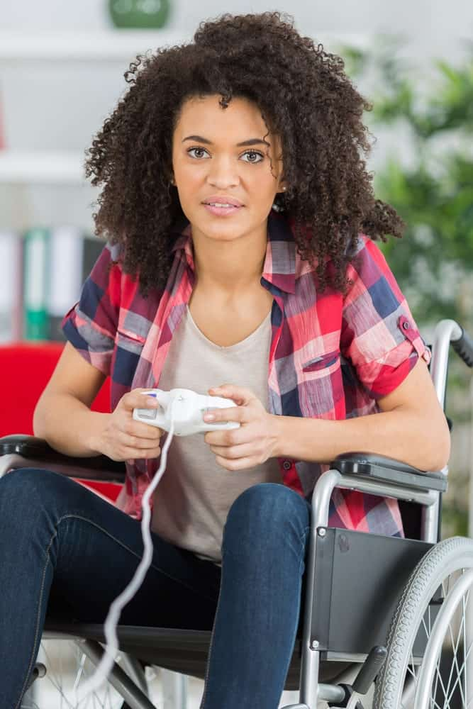 Disabled woman playing video games.