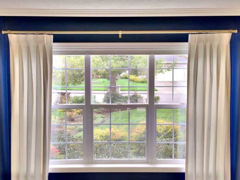 A closer look at this home's custom drapery on its large window set near the living space area.