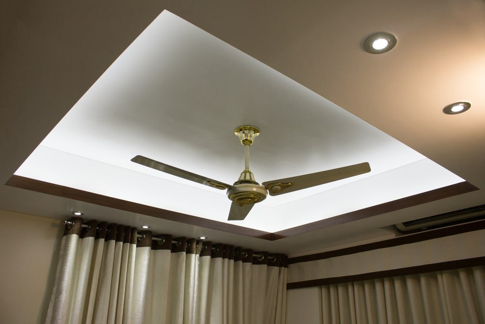 Drop ceiling with lighting and a ceiling fan.