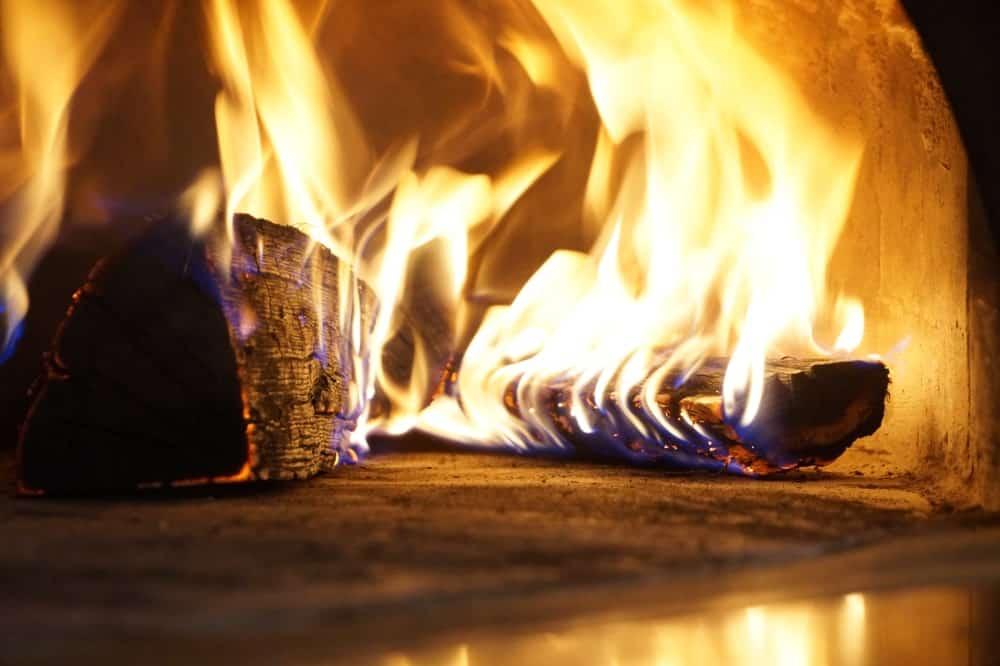 Closeup of firewood burning in an Italian pizzeria.