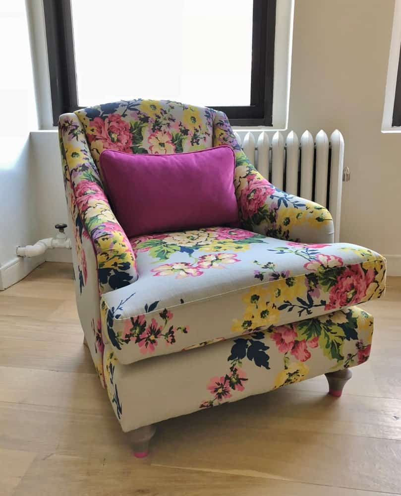 Floral beige armchair by the window.