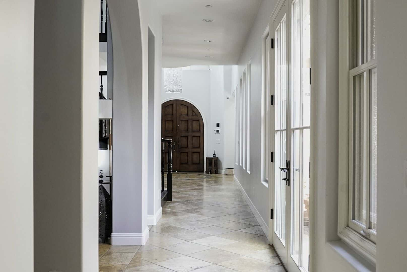 This is the other look of the home's entry, showcasing the doorway and white walls. Images courtesy of Toptenrealestatedeals.com.