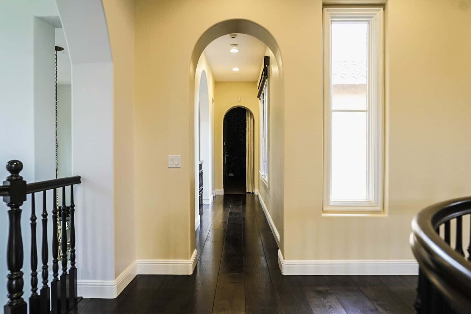 A hallway leading to the indoor amenities, featuring hardwood floors and beige walls. Images courtesy of Toptenrealestatedeals.com.