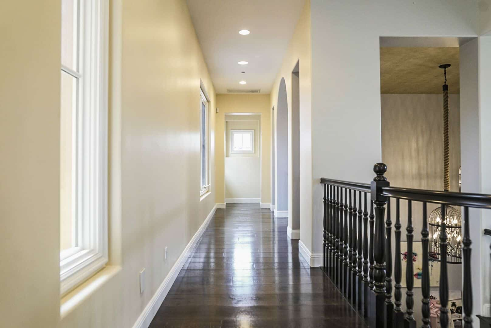 Another look at a hallway in the second floor, featuring beige walls and hardwood floors. Images courtesy of Toptenrealestatedeals.com.