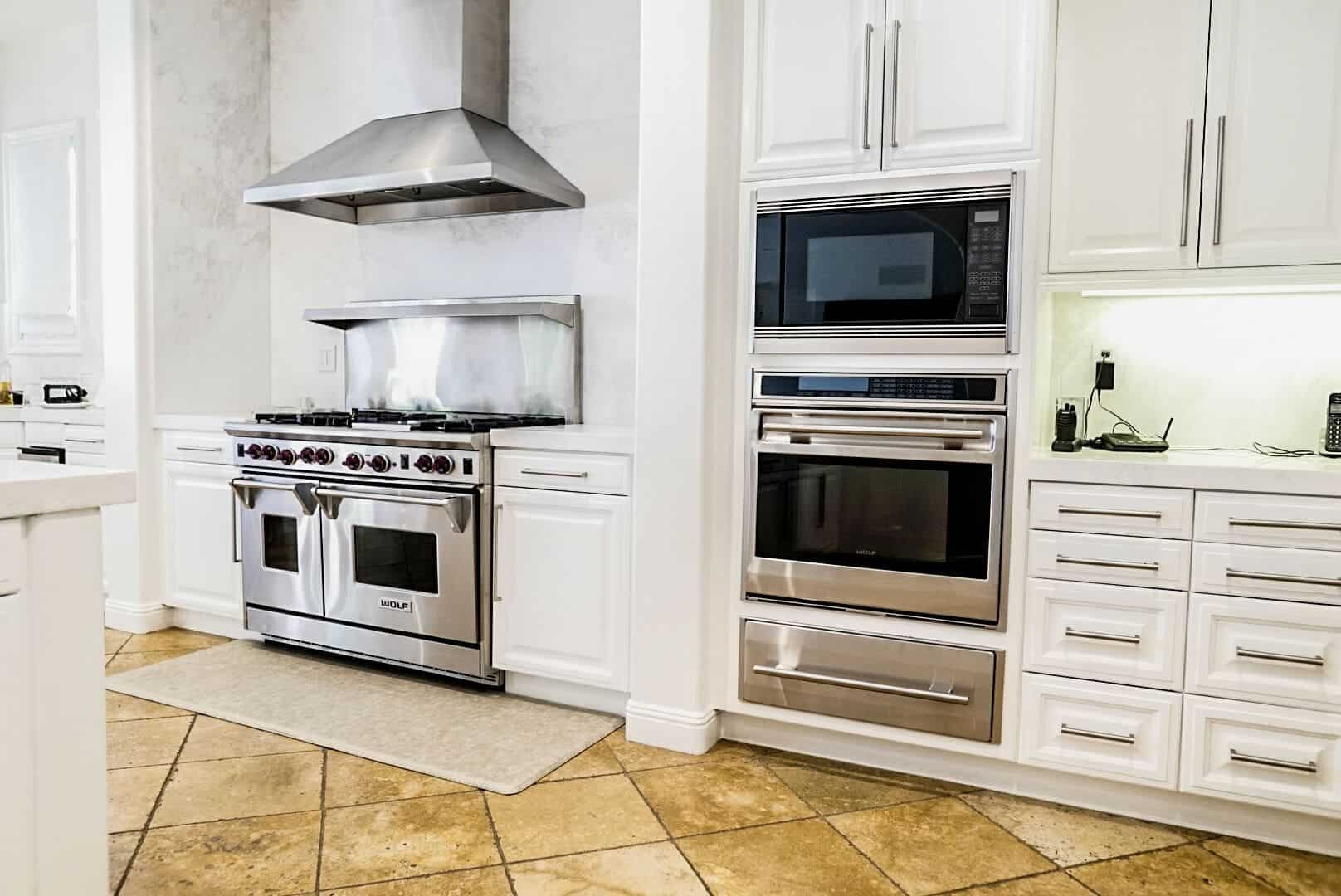 A closer look at the kitchen's high-end appliances, featuring a stainless steel stove and oven. Images courtesy of Toptenrealestatedeals.com.