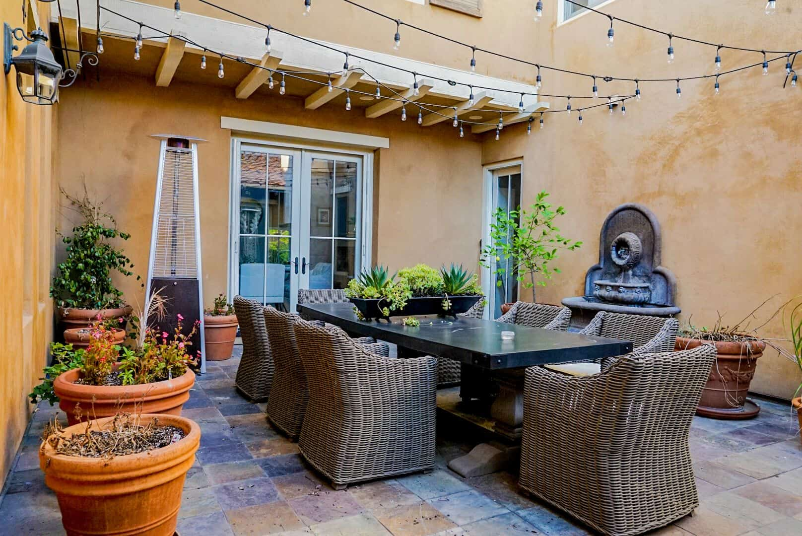 Outside, there's an outdoor dining offering a rectangular dining table set paired with rattan seats. Images courtesy of Toptenrealestatedeals.com.