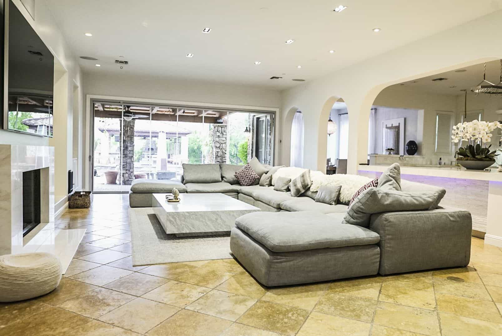 Another look at the home's family living space, focusing on the area's massive gray sofa set. Images courtesy of Toptenrealestatedeals.com.