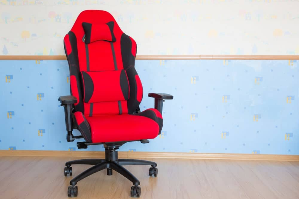 Computer gaming chair on a room with wood flooring.