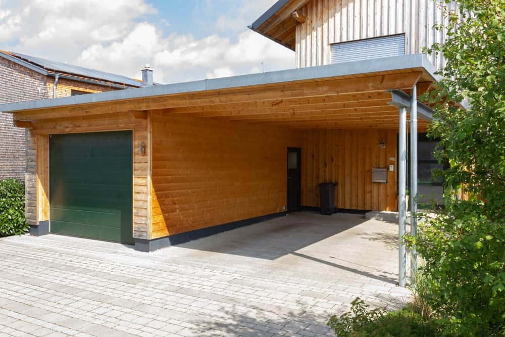 A home with a garage and a carport.