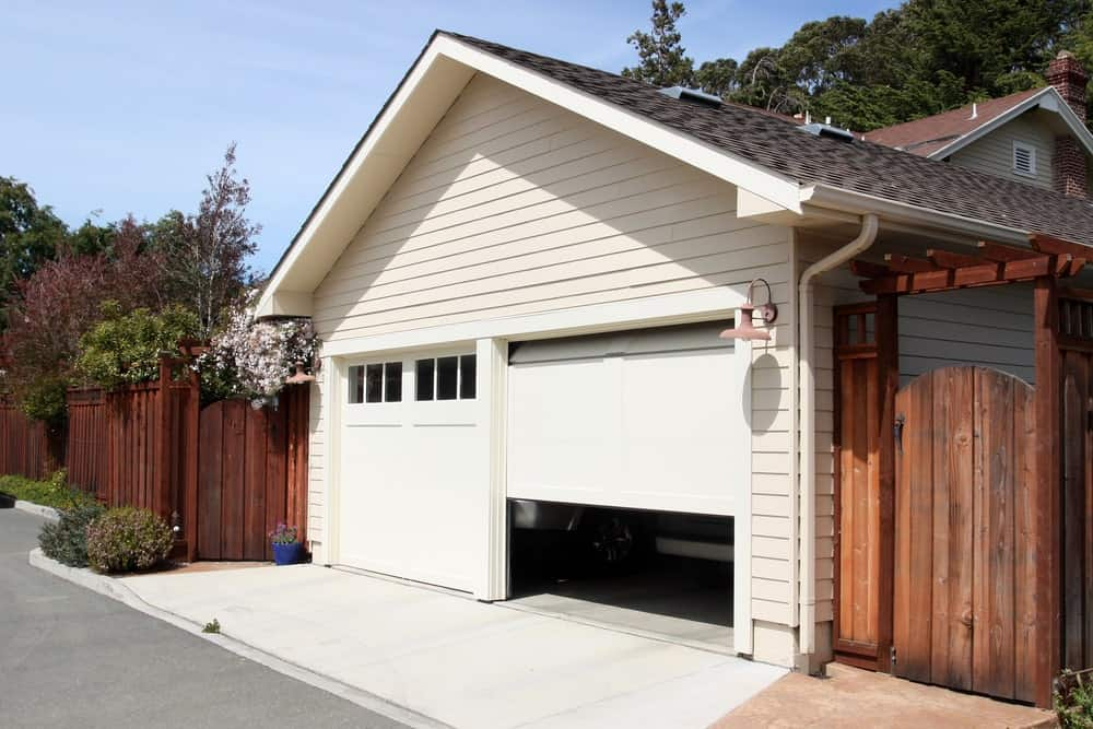 A home garage either opening or closing its rolling door.