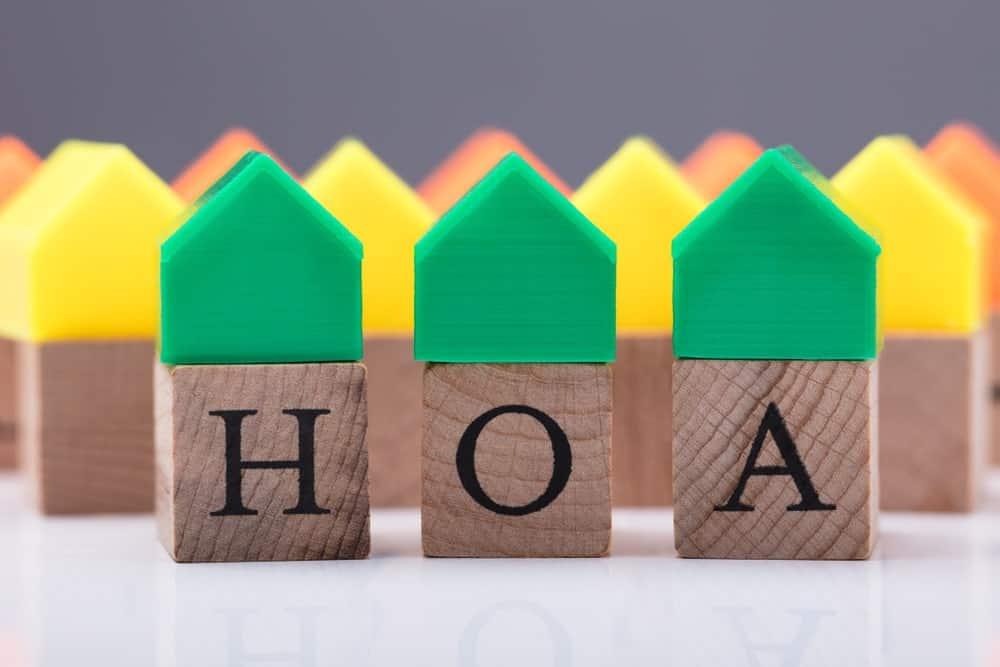 Green houses over HOA wooden blocks.