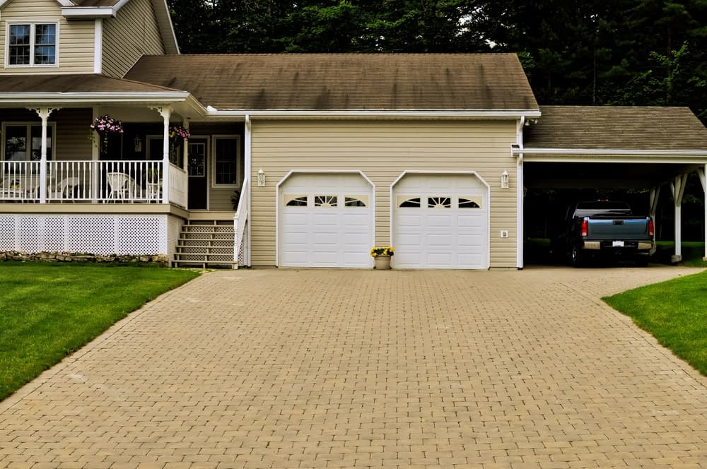 A home with a double garage and a carport.
