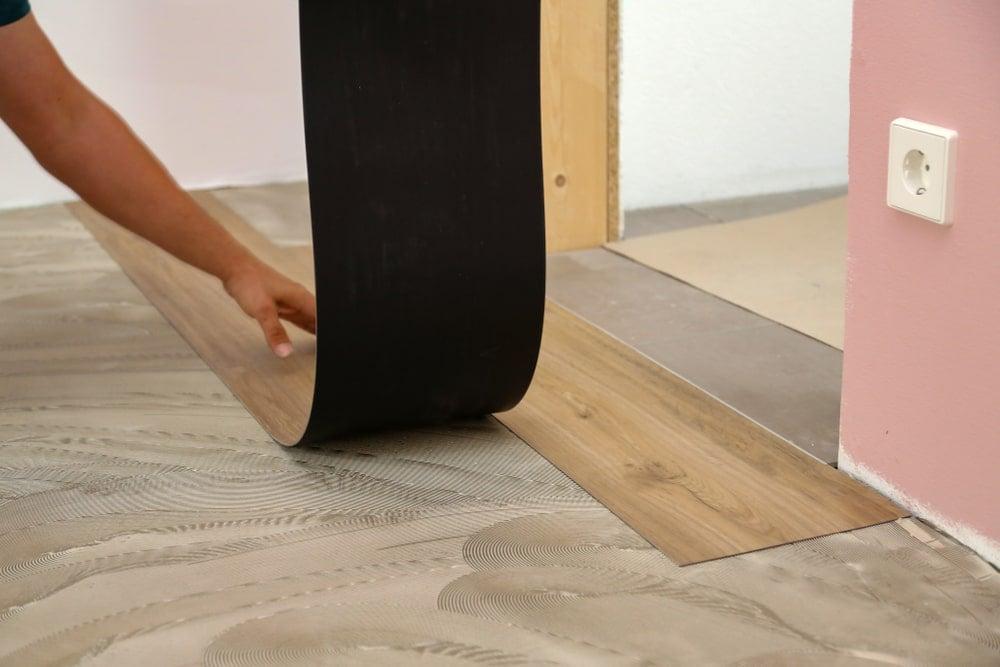 Installing vinyl tiles.