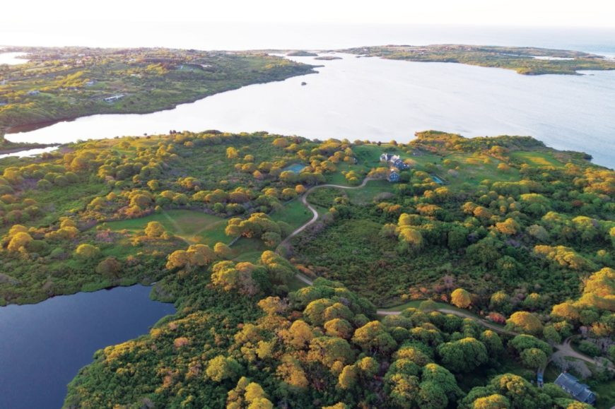 Here's the entire aerial view of the property, showcasing the large farm and the lovely nature surrounding it. Images courtesy of Toptenrealestatedeals.com.