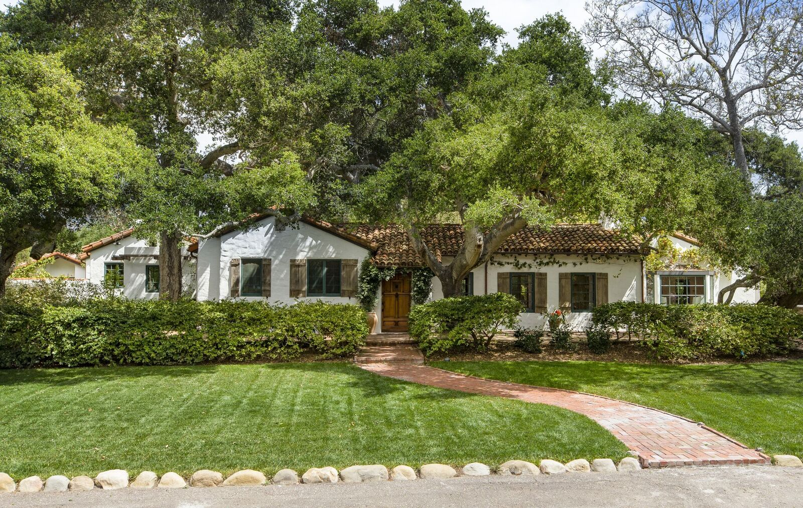 Spanish Revival-style home secluded in lush garden formerly owned by Jeff Bridges, and now Oprah Winfrey.
